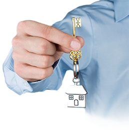 Man holding a key with a house keychain
